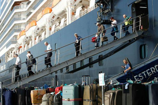 PHOTO: Passengers of the MS Westerdam, back, owned by Holland America Line, disembark at the port of Sihanoukville, Cambodia, Feb. 15, 2020. (Heng Sinith/AP)