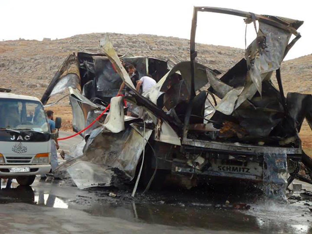 This citizen journalism image provided by Edlib News Network, ENN, which has been authenticated based on its contents and other AP reporting, shows the scene where a car bomb exploded at a crossing point along Syria's volatile border with Turkey, in Bab al-Hawa, Syria, Tuesday, Sept. 17, 2013. (AP Photo/Edlib News Network ENN)