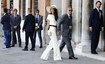 <p>Amal and George Clooney's civil ceremony in Venice turned quite a few heads thanks to the bride's navy and cream suit and sun hat by Stella McCartney.</p>