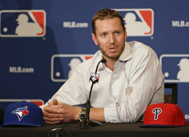 FILE - In this Dec. 9, 2013, file photo, two-time Cy Young Award winner Roy Halladay answers questions after announcing his retirement after 16 seasons in the major leagues with Toronto and Philadelphia at the MLB winter meetings in Lake Buena Vista, Fla. Halladay, Mariano Rivera and Edgar Martinez seem likely to be elected to baseballs Hall of Fame on Tuesday, Jan. 22, 2019. ( AP Photo/John Raoux, File)