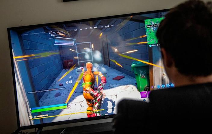 Chase Carson, 15, plays Fortnite on a Playstation 4 gaming console at a friend's home in Raleigh Wednesday, Sept. 23, 2020.