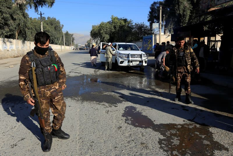 Afghan security forces inspect the site of an attack on a vehicle carrying Japanese doctor Tetsu Nakamura, in Jalalabad