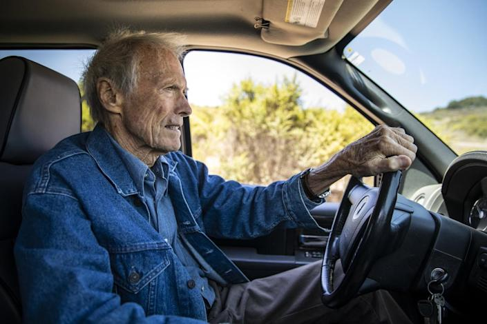 Clint Eastwood driving his truck.