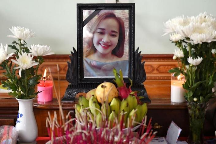 A portrait of Bui Thi Nhung, feared among the 39 people found dead in a truck in Britain, is displayed on an a makeshift altar at her home in Vietnam's Nghe An province (AFP Photo/NHAC NGUYEN)