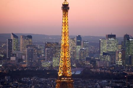 FILE PHOTO: A general view show the illuminated Eiffel Tower and the skyline of La Defense business district at night in Paris