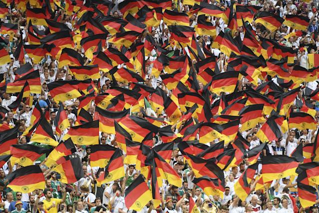 <p>Germany's fans wave German national flags as they cheer prior to the Russia 2018 World Cup Group F football match between Germany and Mexico at the Luzhniki Stadium in Moscow on June 17, 2018. (Photo by PATRIK STOLLARZ / AFP) </p>