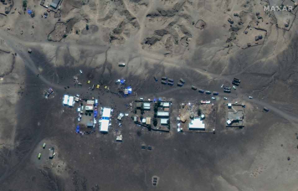 "This satellite image taken Sunday, Nov. 22, 2020 and released by Maxar Technologies, shows Ethiopian refugees gathered at a transit center in the border town of Hamdayet, in eastern Sudan. Ethiopia's prime minister is rejecting growing international consensus for dialogue and a halt to deadly fighting in the Tigray region as ""unwelcome,"" saying his country will handle the conflict on its own as a 72-hour surrender ultimatum runs out on Wednesday. (Maxar Technologies via AP)"
