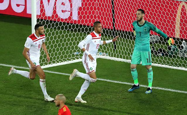 Soccer Football - World Cup - Group B - Spain vs Morocco - Kaliningrad Stadium, Kaliningrad, Russia - June 25, 2018 Spain's David de Gea looks dejected as Morocco's Youssef En-Nesyri celebrates scoring their second goal REUTERS/Mariana Bazo