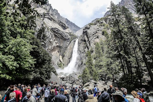 <p>Tourists flock to Lower Yosemite Falls at Yosemite National Park in Yosemite Valley, Calif. (Photo: Eddie Hernandez Photography/iStockphoto/Getty Images) </p>