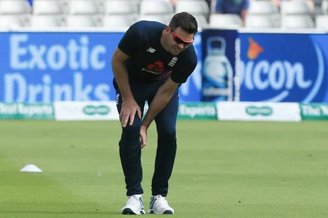 (FILES) In this file photo taken on August 02, 2019 England's James Anderson stretches before play on the second day of the first Ashes cricket Test match between England and Australia at Edgbaston in Birmingham, central England on August 2, 2019.England star James Anderson has been ruled out of the remainder of the Ashes series with a calf injury, the England and Wales Cricket Board announced on August 30, 2019. (AFP Photo/Lindsey Parnaby)