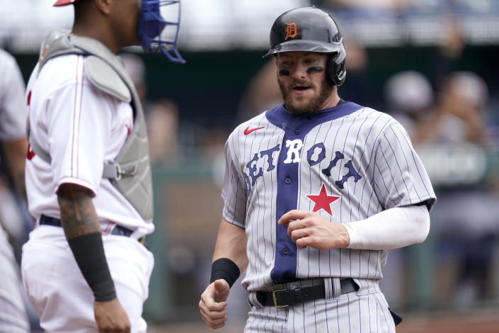 Detroit Tigers' Robbie Grossman runs home to score on an RBI single by Jeimer Candelario during the first inning of a baseball game Sunday, May 23, 2021, in Kansas City, Mo. (AP Photo/Charlie Riedel)