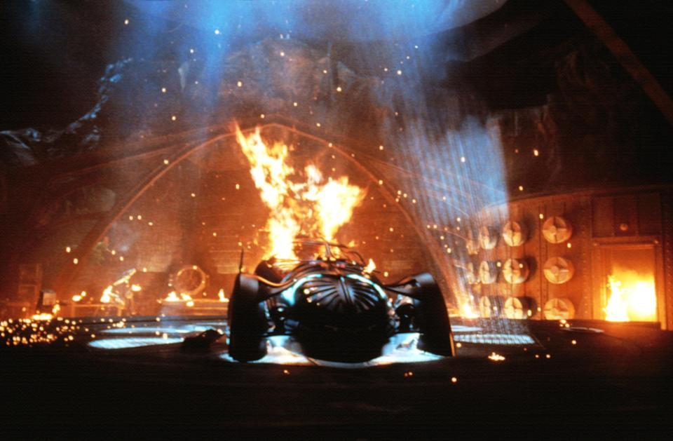 The Batcave goes up in flames in <em>Batman Forever</em>. (Photo: Warner Bros/Courtesy Everett Collection)