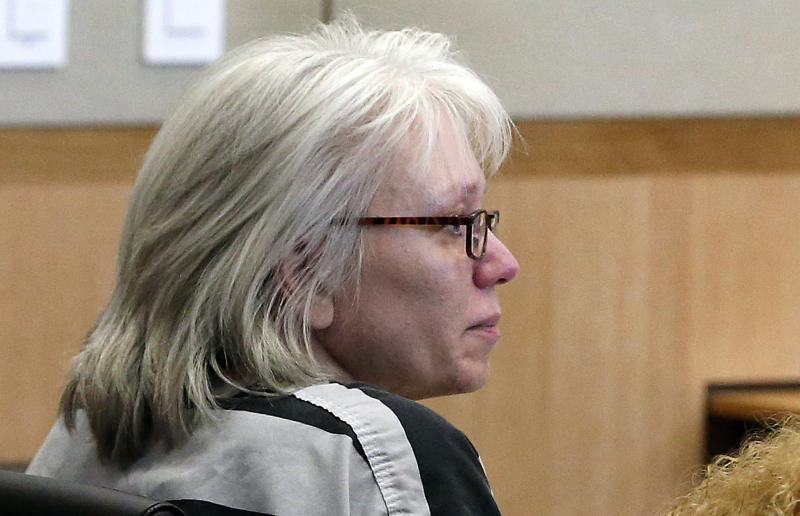 FILE - In this Aug. 1, 2013 file photo, Debra Jean Milke listens to a judge during a hearing as she awaits a retrial in the 1989 shooting death of her 4-year-old son, Christopher, at Maricopa County Superior Court in Phoenix. A judge is allowing Milke to be released on bail as she awaits retrial in the 1989 killing of her young son, a case that had her on death row since 1990 until her conviction was overturn this year. (AP Photo/Ross D. Franklin, Pool, File)