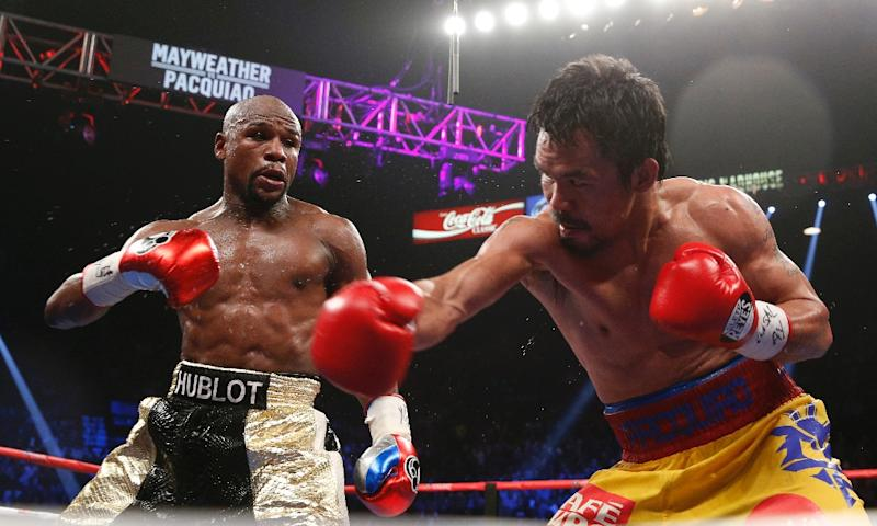 Floyd Mayweather exchanges punches with Manny Pacquiao during their welterweight unification championship bout on May 2, 2015 at MGM Grand Garden Arena (AFP Photo/John Gurzinski)