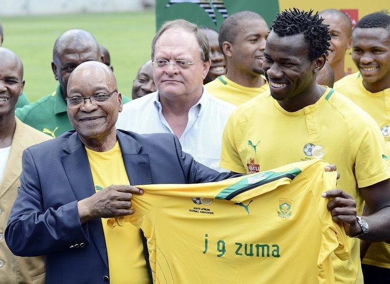 South Africa's President Jacob Zuma (L) receives a team shirt from Bongani Khumalo in Soweto on January 15, 2013