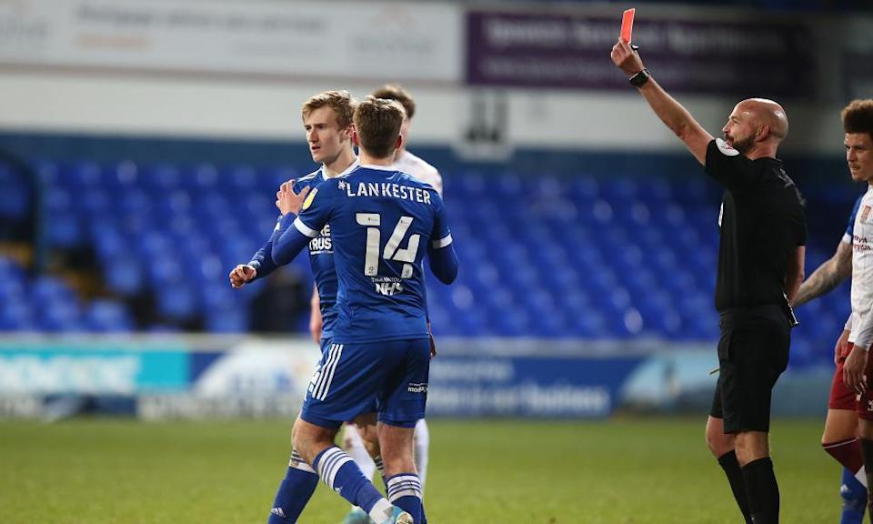 Darren Drysdale sends off Flynn Downes of Ipswich during Tuesday's eventful game - for the referee at least - against Northampton at Portman Road on Tuesday.