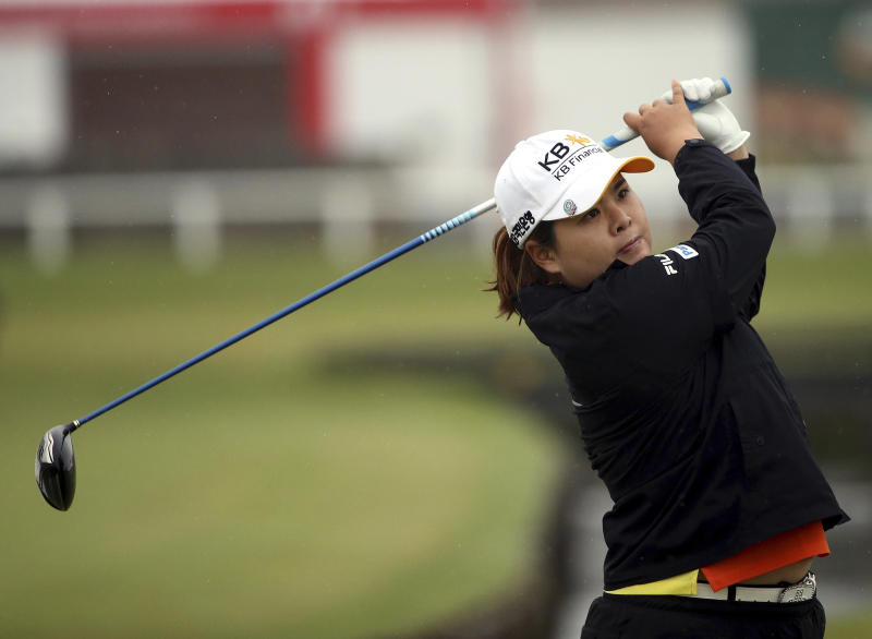 Korea's Inbee Park tees off on the second hole during the first round of the Women's British Open golf championship on the Old Course at St Andrews, Scotland, Thursday Aug. 1, 2013. The 25-year-old from South Korea already has won three majors this year. She is trying to become the first golfer, male or female, to win four in one season. (AP Photo/Scott Heppell)