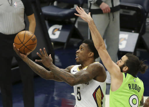 New Orleans Pelicans Eric Bledsoe (5) shoots against Minnesota Timberwolves guard Ricky Rubio (9) in the first quarter during an NBA basketball game, Saturday, Jan. 23, 2021, in Minneapolis. (AP Photo/Andy Clayton-King)