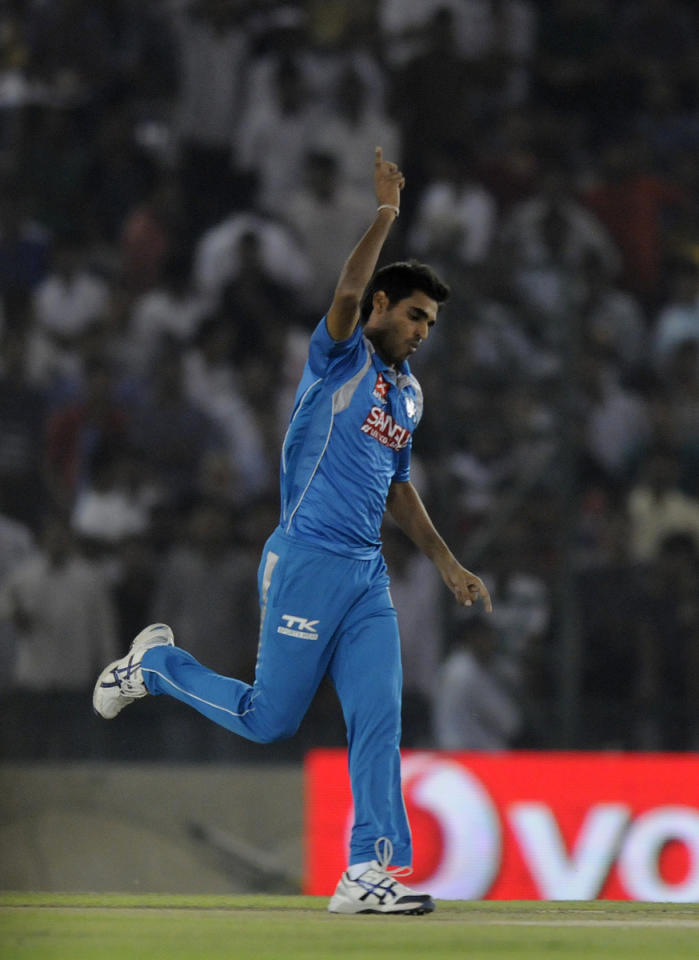Bhuvneshwar Kumar of Pune Warriors celebrates the wicket of Adam Gilchrist captain of Kings XI Punjab during match 29 of the Pepsi Indian Premier League between The Kings XI Punjab and the Pune Warriors held at the PCA Stadium, Mohali, India  on the 21st April 2013. (BCCI)