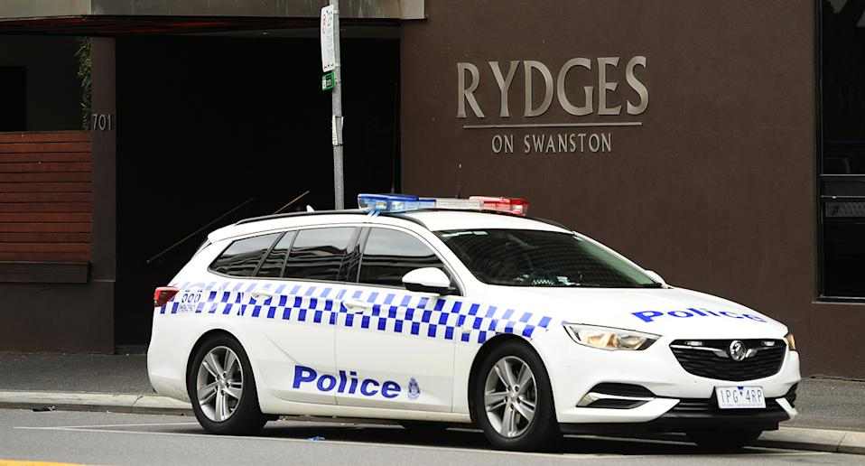 A police car sits outside the Rydges on Swanston hotel in Melbourne.