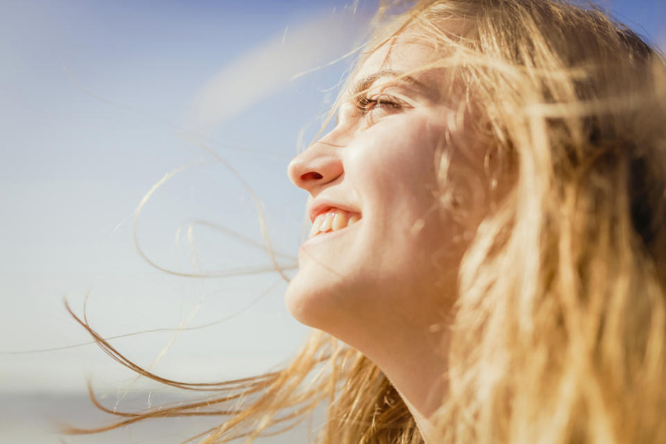 Sunshine may do more than just boost your mood, with research linking higher exposure to reduced coronavirus death rates. (Posed by a model, Getty Images)