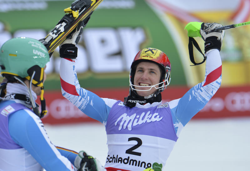 Austria's Marcel Hirscher celebrates winning the gold medal after the second run of the men's slalom at the Alpine skiing world championships in Schladming, Austria, Sunday, Feb. 17, 2013. (AP Photo/Kerstin Joensson)