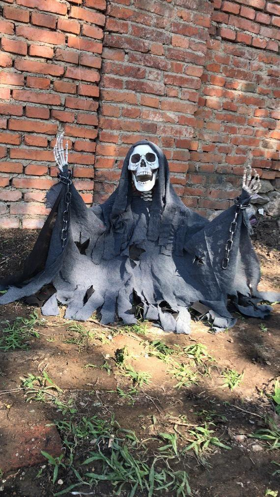 """<p><strong>Retrohalloweendecor</strong></p><p>etsy.com</p><p><strong>$38.00</strong></p><p><a href=""""https://go.redirectingat.com?id=74968X1596630&url=https%3A%2F%2Fwww.etsy.com%2Flisting%2F636645760%2Falcatraz-unchained-life-size-outdoor&sref=https%3A%2F%2Fwww.womansday.com%2Flife%2Fentertainment%2Fg2496%2Foutdoor-halloween-decorations%2F"""" rel=""""nofollow noopener"""" target=""""_blank"""" data-ylk=""""slk:Shop Now"""" class=""""link rapid-noclick-resp"""">Shop Now</a></p><p>For the hardcore Halloween decorators, go big with this life-sized grave and skeleton. Just don't be surprised when its presence elicits screams. </p>"""