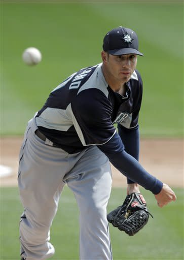 Seattle Mariners starting pitcher Jon Garland delivers against the Los Angeles Dodgers in the first inning of an exhibition spring training baseball game on Saturday, March 9, 2013, in Glendale, Ariz. (AP Photo/Mark Duncan)