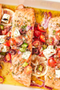 """<p>We love this meal because it comes with lots of veggies! If you want to be extra-healthy, serve the salmon over a bed of rocket or spinach.</p><p>Get the <a href=""""https://www.delish.com/uk/cooking/recipes/a29205150/greek-salmon-recipe/"""" rel=""""nofollow noopener"""" target=""""_blank"""" data-ylk=""""slk:Greek Salmon"""" class=""""link rapid-noclick-resp"""">Greek Salmon</a> recipe.</p>"""