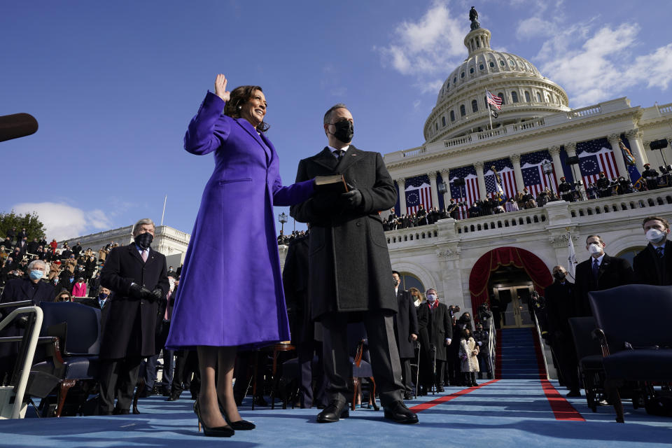 Kamala Harris is sworn in as Vice President by Supreme Court Justice Sonia Sotomayor as her husband Doug Emhoff holds the Bible during the 59th Presidential Inauguration at the U.S. Capitol in Washington, Wednesday, Jan. 20, 2021. (AP Photo/Andrew Harnik, Pool)