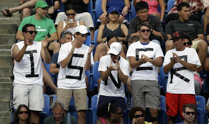 Fans cheer for John Isner during a third round match against Philipp Kohlschreiber, of Germany, at the 2013 U.S. Open tennis tournament, Saturday, Aug. 31, 2013, in New York. (AP Photo/David Goldman)