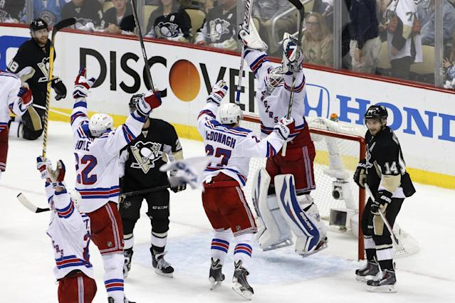 New York Rangers goalie Henrik Lundqvist (30) leaps as time expires in Game 7 of a second-round NHL playoff hockey series against the Pittsburgh Penguins in Pittsburgh Tuesday, May 13, 2014. The Rangers won 2-1, and advanced to the conference finals. (AP Photo)