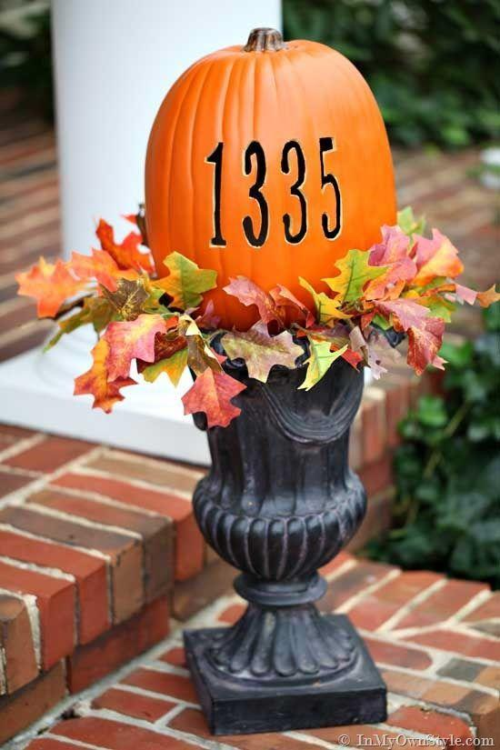 """<p>Let your neighbors and trick-or-treaters know just how serious you are about Halloween with this pumpkin, customized with your home address. </p><p><em><a href=""""https://inmyownstyle.com/finding-fall-home-tour.html"""" rel=""""nofollow noopener"""" target=""""_blank"""" data-ylk=""""slk:Get the tutorial at In My Own Style »"""" class=""""link rapid-noclick-resp"""">Get the tutorial at In My Own Style »</a></em> </p>"""