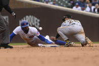 Chicago Cubs' Jason Heyward, left, slides safely past Pittsburgh Pirates second baseman Adam Frazier (26) during the seventh inning of a baseball game, Saturday, May 8, 2021, in Chicago. (AP Photo/Matt Marton)