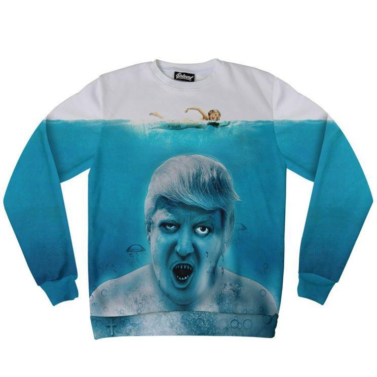 <i>You can also get your hands on a Jaws-themed Trump design. [Photo: Beloved Shirts]</i>