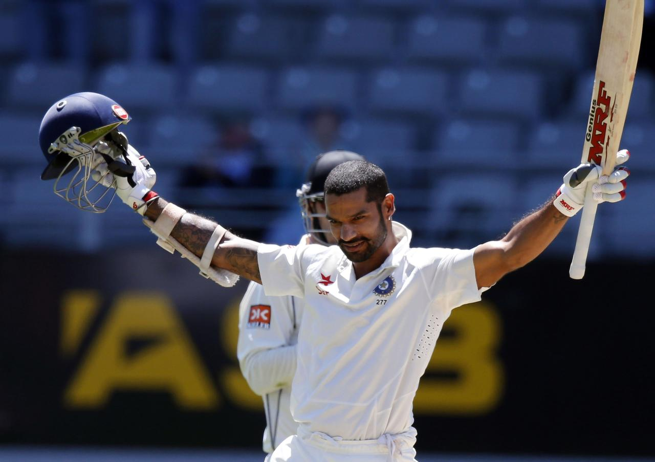 India's Shikhar Dhawan celebrates scoring a century during his second innings on day four of the first international test cricket match against New Zealand, at Eden Park in Auckland, February 9, 2014. REUTERS/Nigel Marple (NEW ZEALAND - Tags: SPORT CRICKET)