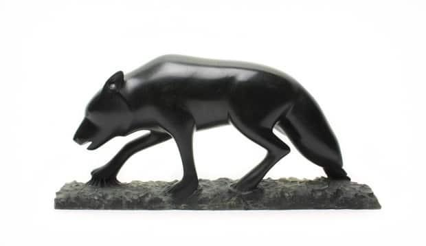 This carving, which was being sold for $3,200, was one of two John Sabouring carvings allegedly stolen from a gallery in Edmonton last week. (Alberta Craft Gallery - image credit)