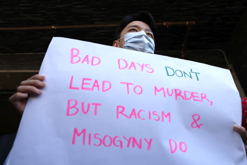 Steve Kong, 35, holds a sign at a protest to denounce hate against the Asian American and Pacific Islander communities, following the deadly shootings at Young's Asian Massage in Georgia, in Koreatown in Los Angeles