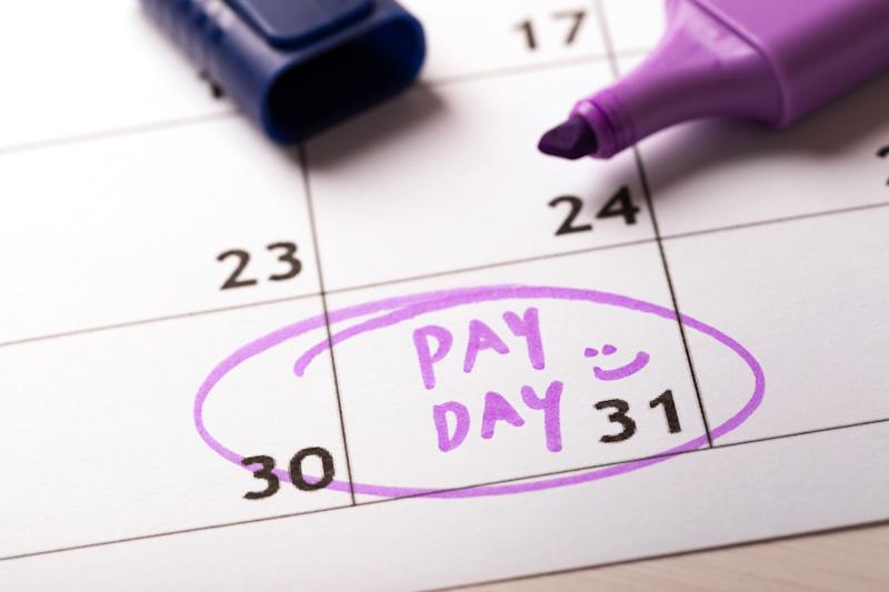 Word payday written on calendar and highlighted