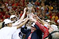 Owner Herb Simon of the Indiana Fever hoists the WNBA Championship trophy after defeating the Minnesota Lynx in Game Four of the 2012 WNBA Finals on October 21, 2012 at Bankers Life Fieldhouse in Indianapolis, Indiana. (Photo by Michael Hickey/Getty Images)