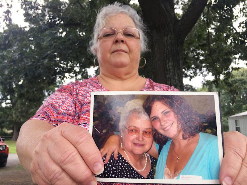 Heather Heyer's mum holds a picture of her daughter and her mother: AP