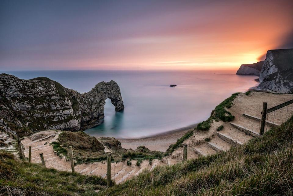"""<p>Home to spectacular prehistoric rock formations, gorgeous pebble beaches strewn with fossils and terrific views, Dorset is one of the south coast's best spots for a short break. Its sleepy countryside villages inspired celebrated English writer Thomas Hardy, who brought their rural charm to life in his bestselling novels.</p><p>It's the perfect place for a relaxing railway break, where you can stop off to see all the incredible views along the coast, and explore the region's inspirational gardens. </p><p>On our five-day Jurassic Coast staycation, you'll take a trip to Exbury Gardens, and take in cute villages and stunning scenery as you spend a day on the wonderful Watercress Line. Try it on Prima's Jurassic Coast break from £595.</p><p><strong>When:</strong> June and September 2022</p><p><a class=""""link rapid-noclick-resp"""" href=""""https://www.primaholidays.co.uk/tours/jurassic-coast-bournemouth-hampshire-rail"""" rel=""""nofollow noopener"""" target=""""_blank"""" data-ylk=""""slk:FIND OUT MORE"""">FIND OUT MORE</a></p>"""