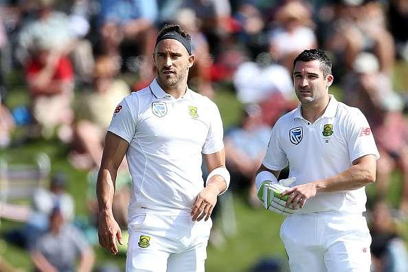 DUNEDIN, NEW ZEALAND - MARCH 08: Faf du Plessis (L), and Dean Elgar of South Africa look on during day one of the First Test match between New Zealand and South Africa at University Oval on March 8, 2017 in Dunedin, New Zealand. (Photo by Dianne Manson/Getty Images)
