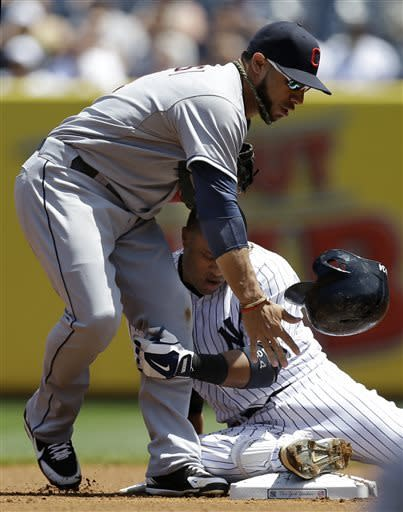 Cleveland Indians shortstop Mike Aviles (4) collides with New York Yankees Robinson Cano after Cano slid hard into second on a first-inning double in a baseball game at Yankee Stadium in New York, Wednesday, June 5, 2013. (AP Photo/Kathy Willens)