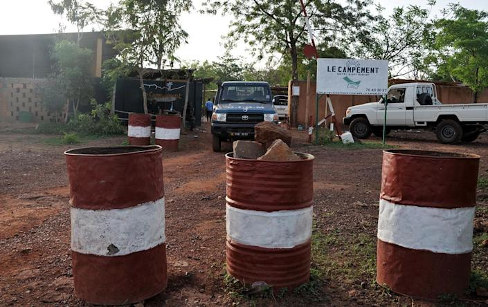 <p>A vehicle of the gendarmarie is parked at the entrance to the Kangaba tourist resort in Bamako on June 19, 2017, a day after suspected jihadists stormed the resort, briefly seizing more than 30 hostages and leaving at least two people dead. (Habibou Kouyate/AFP/Getty Images) </p>