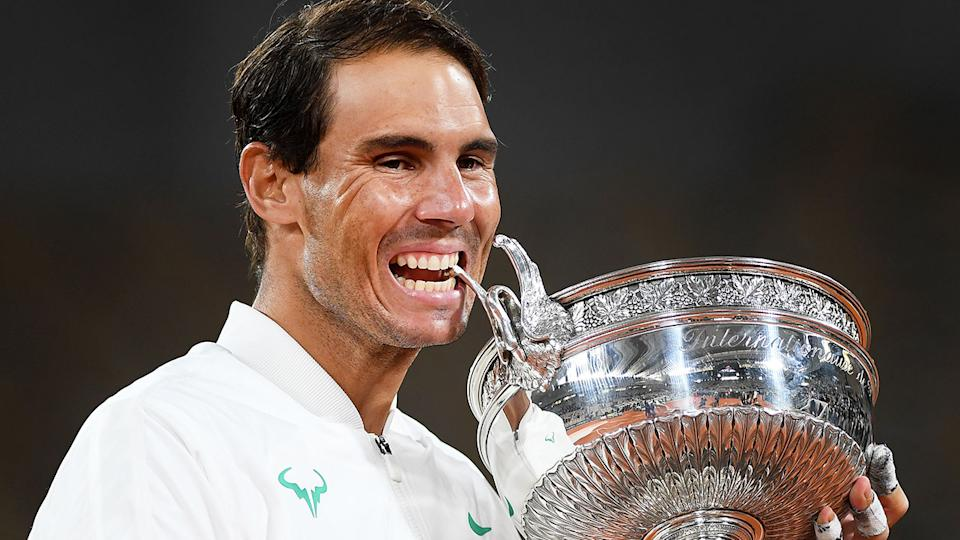 Pictured here, 2020 French Open champion Rafael Nadal poses with his trophy.