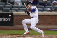 New York Mets' Pete Alonso reacts after being hit by a ball during the eighth inning of a baseball game against the San Diego Padres at Citi Field, Sunday, June 13, 2021, in New York. (AP Photo/Seth Wenig)