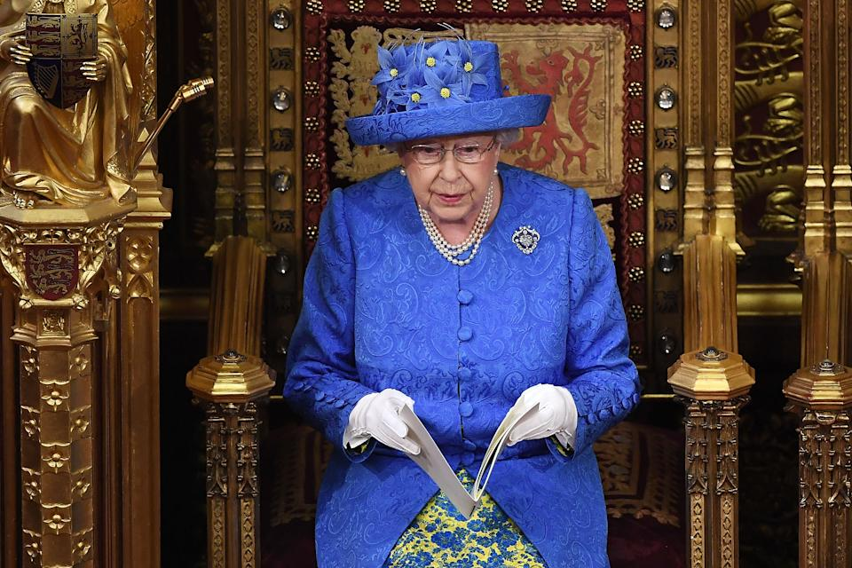 Britain's Queen Elizabeth II delivers the Queen's Speech during the State Opening of Parliament in the Houses of Parliament in London on June 21, 2017. - Queen Elizabeth II will formally open parliament and announce the British government's legislative programme on Wednesday, two days later than planned. The state opening, a ceremony full of pomp in which the monarch reads out the Queen's Speech detailing the government's programme for the coming year, was due to take place on June 19, but was delayed after Britain's Prime Minister Theresa May's Conservative party lost their majority in the House of Commons in the June 8 election. (Photo by Carl Court / POOL / AFP)        (Photo credit should read CARL COURT/AFP via Getty Images)