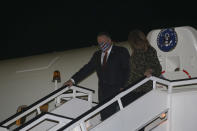U.S. Secretary of State Mike Pompeo, left, and his wife Susan, arrive in the northern city of Thessaloniki, Greece, Monday, Sept. 28, 2020. Secretary Pompeo is on a two-day visit to Greece during which he will meet Greek Prime Minister Kyriakos Mitsotakis and Foreign Minister Nikos Dendias, and he will visit the Naval Support Activity base of Souda on the island of Crete. (AP Photo/Giannis Papanikos, Pool)