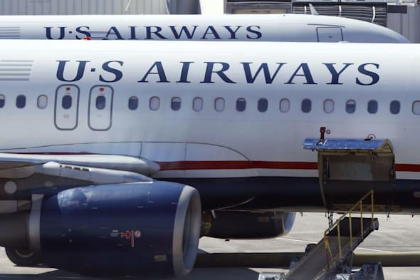 One hospitalised after US airways plane makes emergency landing without its nose gear